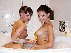 11 pics & movs - Naked lesbians fuck in the bathroom